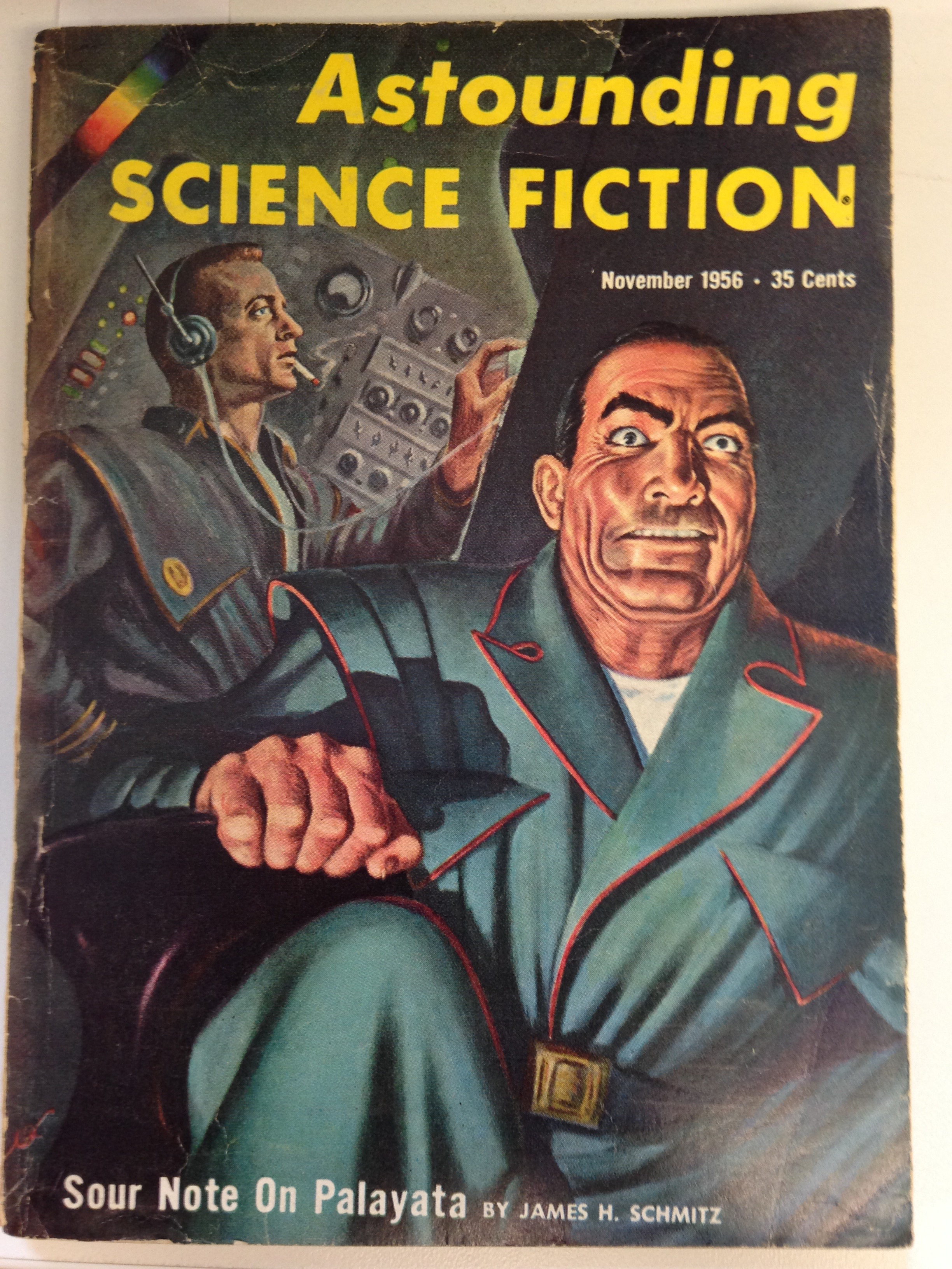 Cover of Astounding Science Fiction. Two men appear to be in a very stressful situation inside of a submarine.