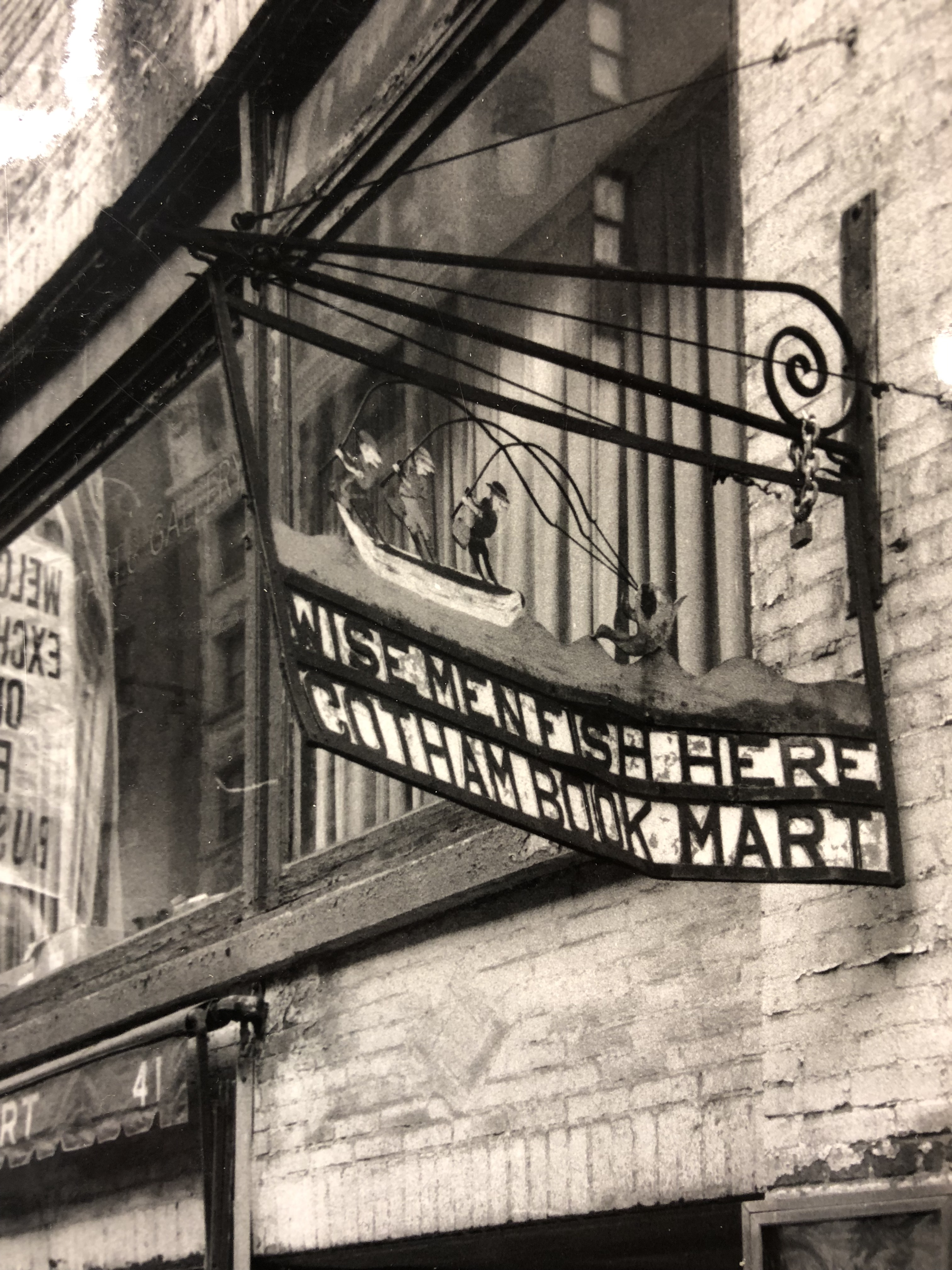 "Original Gotham Book Mart sign that declares ""Wise Men Fish Here"""