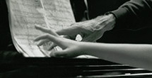 Hands of pianist Rieko Aizawa and cellist Paul Tortelier at the piano, 1992.