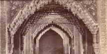 Sepia photo of an aisle of Alhambra showing the arches