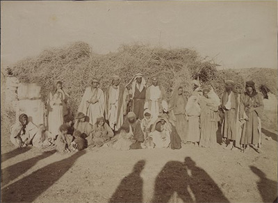 Photo showing a group of Bedouins in front of one of their homes.