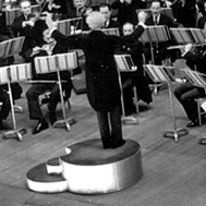 Stokowski, on his personal podium, conducting the Philadelphia Orchestra, from the Leopold Stokowski Papers