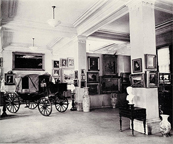 Photograph including the carriage in which Empress Eugenie escaped at the fall of the Second Empire.