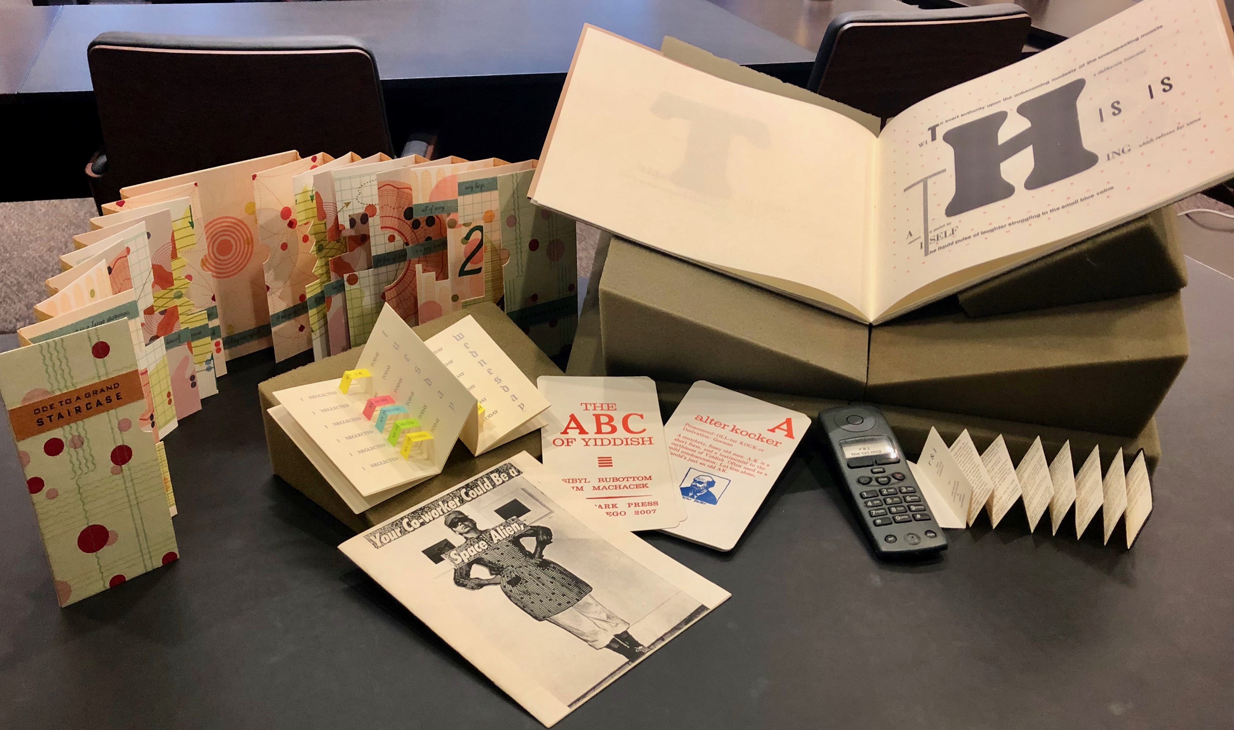 A Collection of Artists' Books from the Kislak Center for Special Collections. Books by (clockwise from upper right): Johanna Drucker, Elizabeth Pendergrass, Sibyl Rubottom, Tana Kellner, Patricia M. Smith, and Julie Chen. Photo by Camille Davis.
