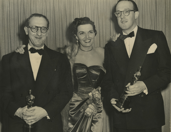 "Ray Evans, Jane Russell and Jay Livingston at The Academy Awards with their first Oscar for Best Song, ""Buttons and Bows,"" 1949."