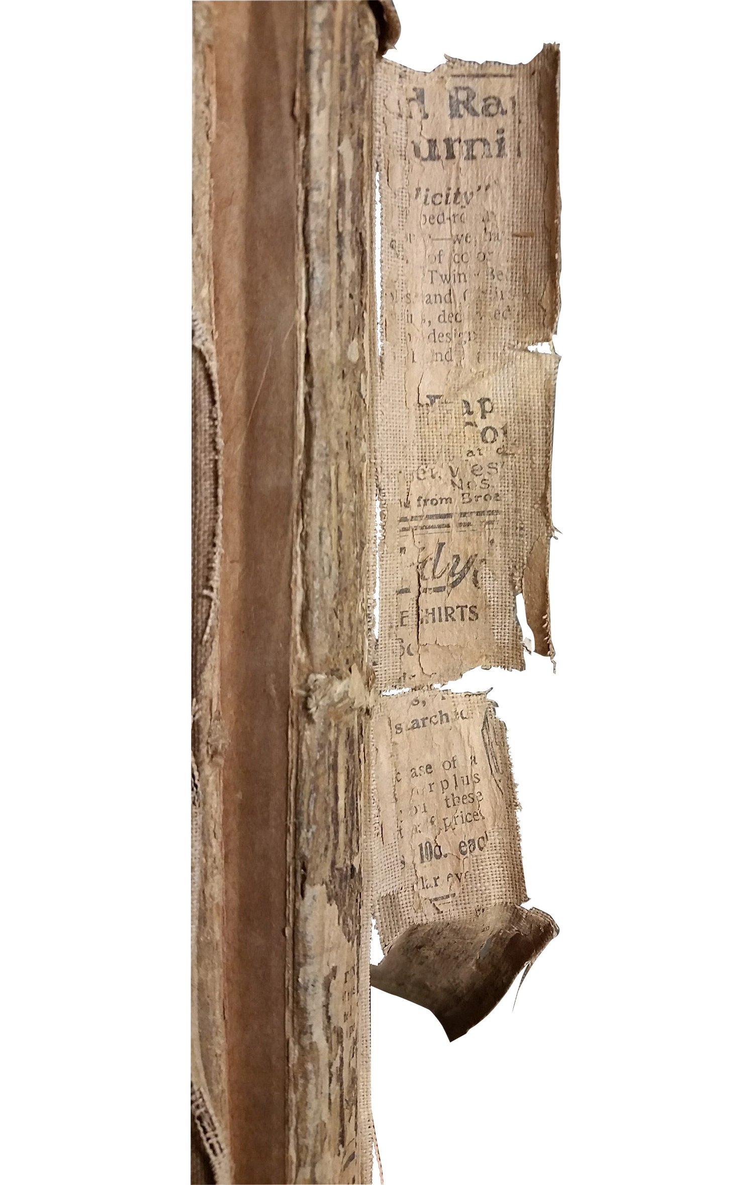 scan of the fragile and decayed binding of the book, some text visible but unreadable