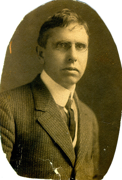 A black-and-white formal photograph of Theodore Dreiser in a suit and tie