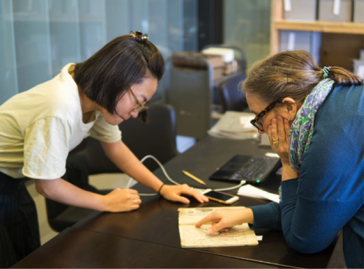 Professor Davis (right) and Naoko Adachi, doctoral candidate in East Asia Study at Penn, review a book from the Tress Collection.
