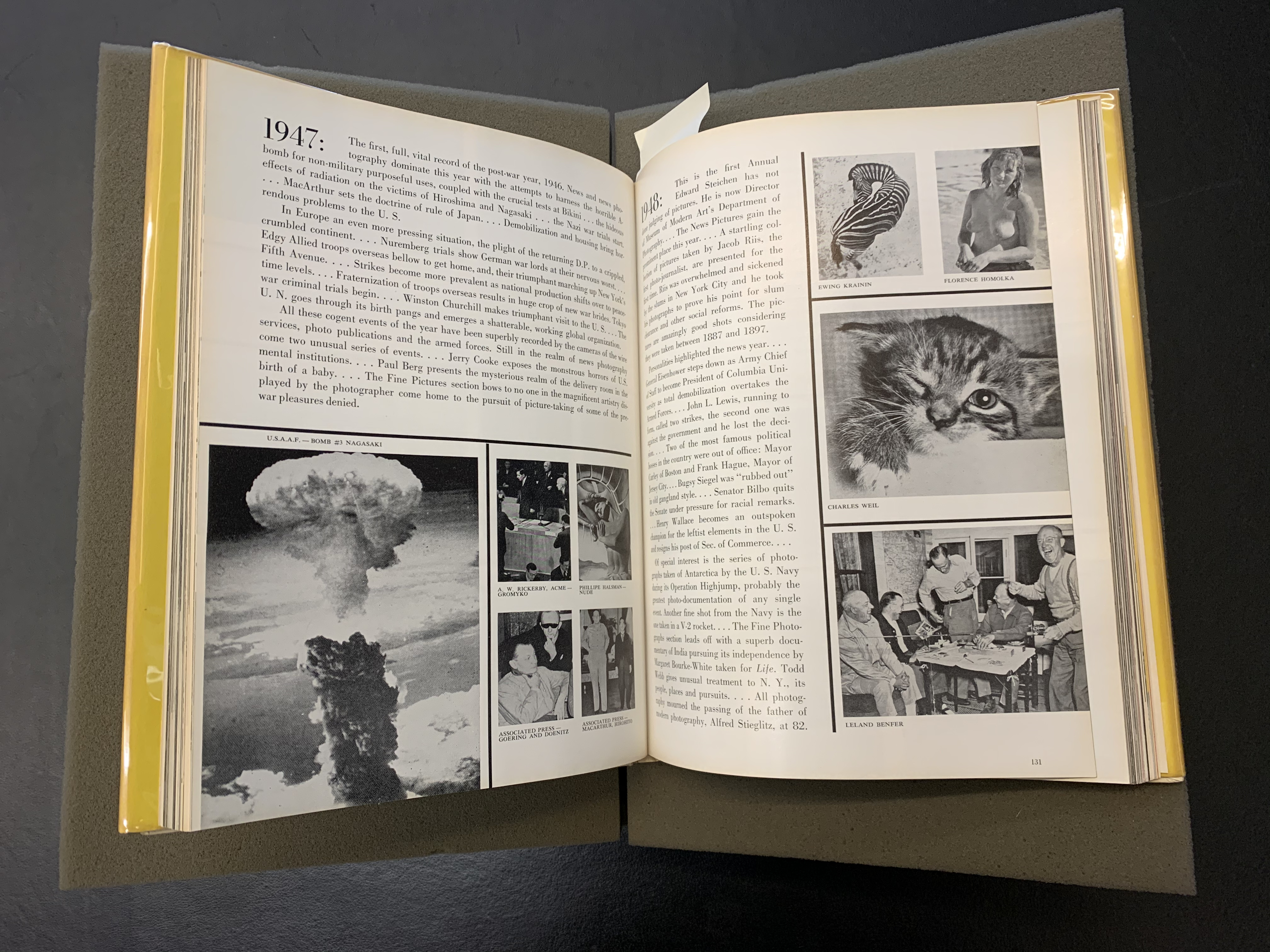 Open copy of The Picture Universe showing photographs from the year 1947