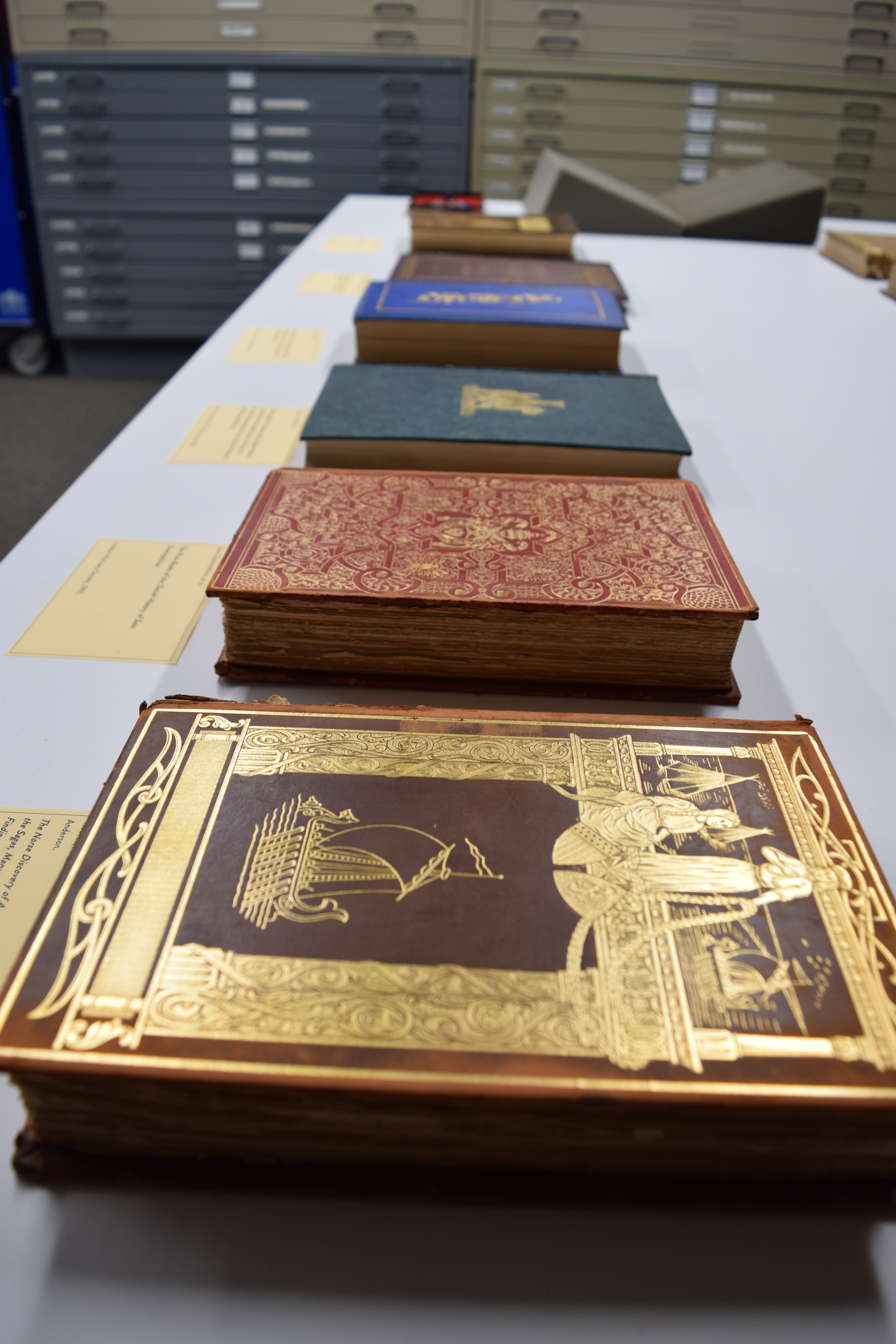 An assortment of rare books on a table