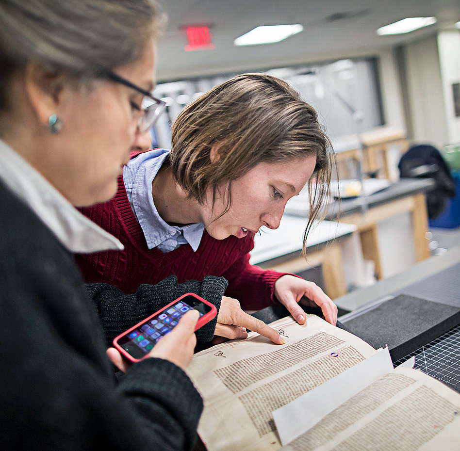 Examining a codex in the Conservation Lab