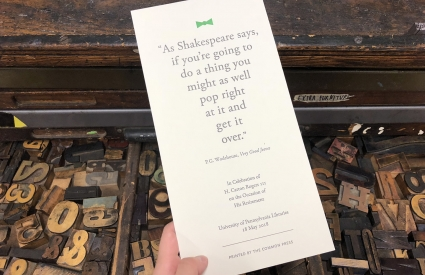 Image of letterpress print held over open type drawer