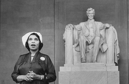 Marian Anderson singing at the Lincoln Memorial. Seated statue of Lincoln in the background.