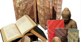 Collection of material texts, including a sculpture of the Buddha