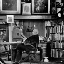 Photograph of Horace Howard Furness in the library of his summer home, Lindenshade