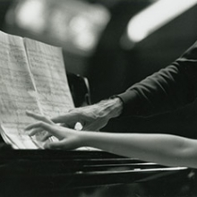 Hands of pianist Rieko Aizawa and cellist Paul Tortelier at the piano, 1992. Photo by Peter Checchia.