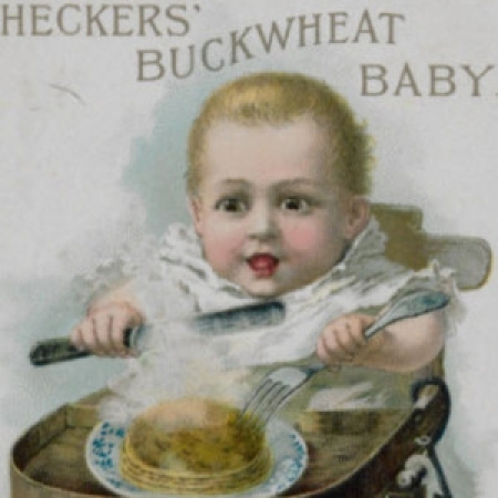 Illustration of baby eating pancakes