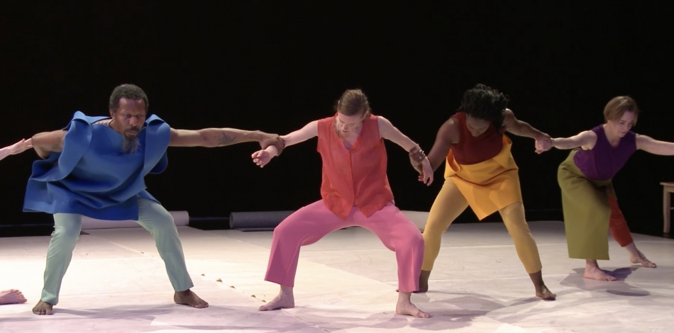 Four dancers holding hands