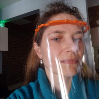 Photo of Varvara modeling plastic face shield with 3D printed headband