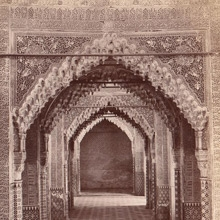 Sepia photo showing an aisle of Alhambra