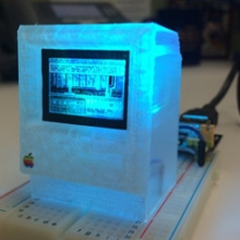 3D-printed Arduino-powered replica of a Macintosh computer running a graphical adventure game based on William Gibson's novel Neuromancer. Model by DB Bauer, University of Maryland. Used with permission