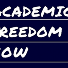 Academic Freedom Now (displayed as if written in chalk)