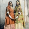 Old postcard with hand colored photographs of women in Trinidadian dress