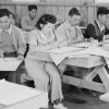 Photo of people working at tables in classroom